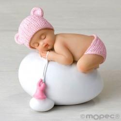 Figura niña bebé rosa durmiendo sobre huevo