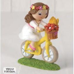 Figura pastel niña Comunión en bici